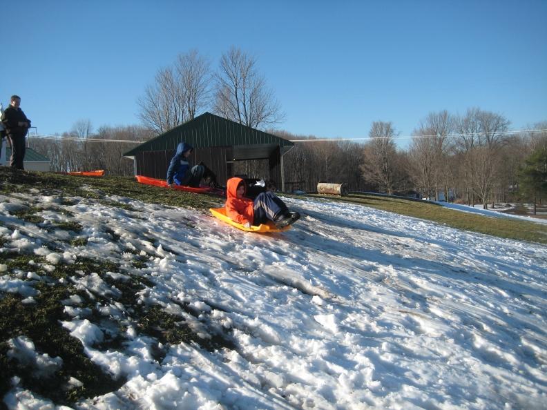 rangers on a sledding hill